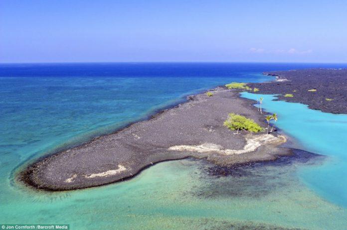 An image of the beautiful turquoise waters of Kiholo Bay located on the Kohala Coast on volcanic Big Island