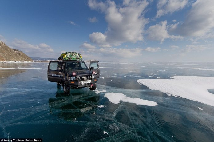 The friends drove for a week over the frozen lake which had cracks of up to two-metres wide