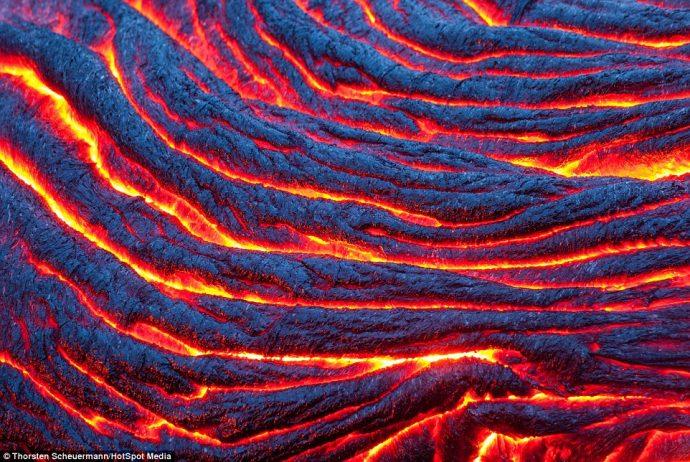 Thorsten Scheuermann captures the flowing, red-hot lava of the Kilauea Volcano near Kalapana in Hawaii
