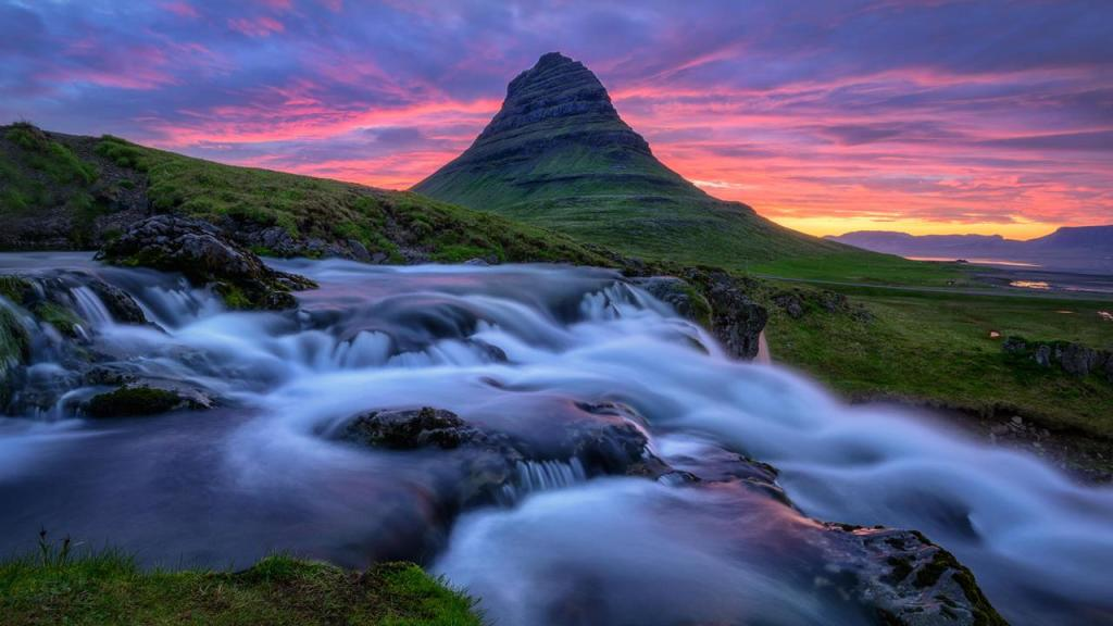 The summit of dazzling Kirkjufell is over 1,500 feet above sea level, actually a biggest landmark in the village of nearly 1000 residents.