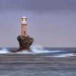 The Little Tourlitis Lighthouse perched on the islet of Tourlitis Greece.