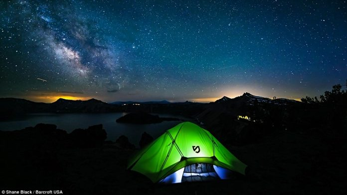 A glowing tent sits beneath the milky way in 2013, in Crater Lake, Oregon, in another of Shane Black's incredible images