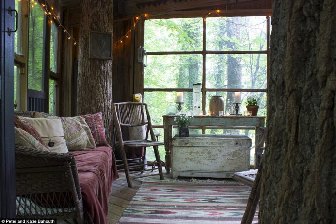 The rustic living room has been decked out with shabby chic furniture, while colourful accessories add warmth to the cosy scheme