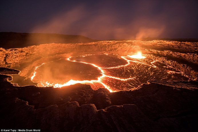 These incredible images by Czech photographer Karel Tupy capture the world's oldest continuously active lava lake