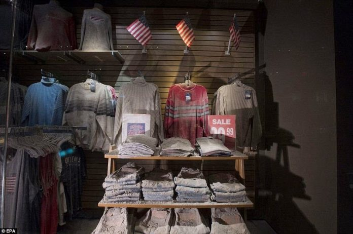 The front window of Chelsea Jeans, a store that was located on Broadway near Fulton Street at the time of the attack and has since been moved into the museum.