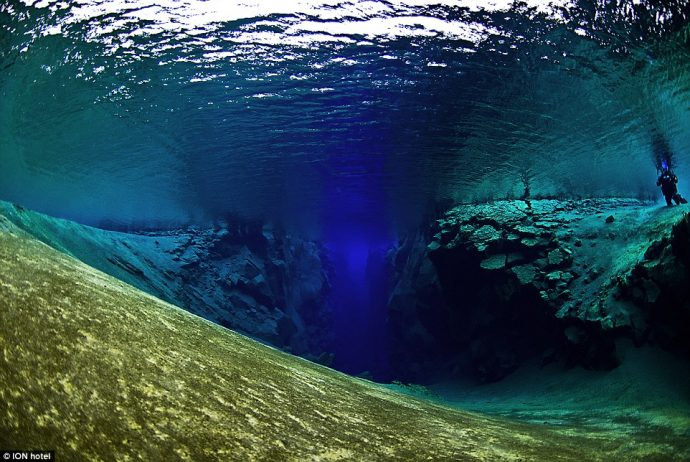 The underwater Silfra fissure Guests can snorkel and scuba dive here and can touch the tectonic plates of America and Europe