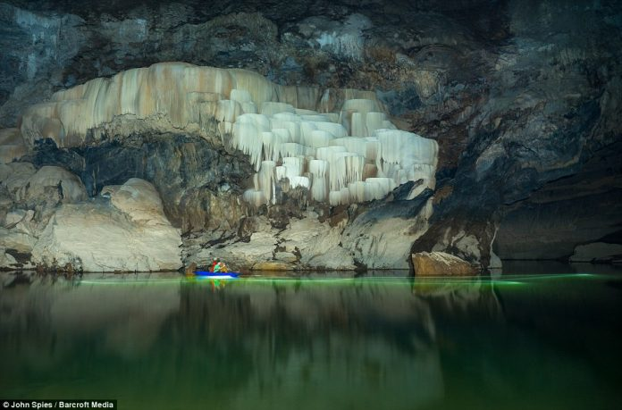 Visitors to Tham Khuon Xe can rent canoes or kayaks and paddle upstream to view the stunning calcifications on the cave walls