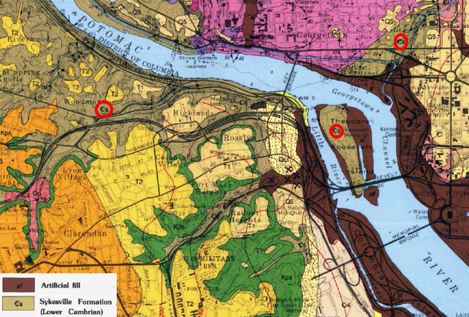 500-million-year-old (Cambrian Period) crystalline bedrock outcrops are buried beneath younger Coastal Plain sediments and artificial fill east of Teddy Roosevelt Island and Rock Creek Park