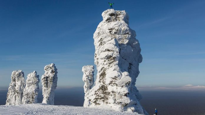 Manpupuner rock formations are set of 7 huge stone pillars situated on a flat plateau, west of the Ural Mountains in the Troitsko-Pechorsky