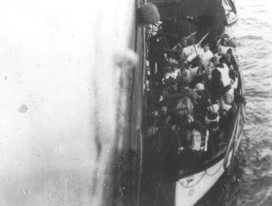 Titanic lifeboat next to the Carpathia. April 15, 1912