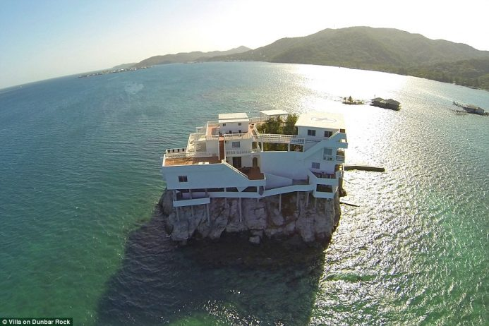 The incredible Villa on Dunbar Rock is nestled in the Caribbean and is completely surrounded by pristine waters