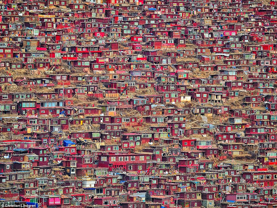 Among the green rolling hills in the Larung Gar Valley in China, the last thing you would expect to see in the countryside are thousands of red wooden huts that have been built in a massive cluster