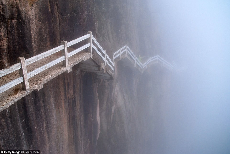 This vertigo-inducing trail Mount Hua Shan in China. Situated in Huangshan Yellow Mountain, the risky walkway is lined with tight and rickety walkways high up in the air, with long, lethal drop below