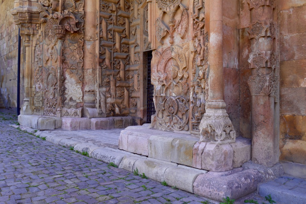 The stone carving is the same quality as the main mosque portal but is less dense and appears, in certain places, to be unfinished.
