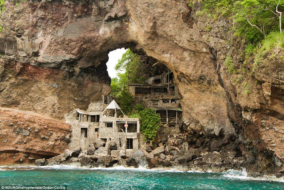 It is the ultimate Robinson Crusoe retreat - a secluded resort nestled under a rocky arch surrounded by the turquoise Caribbean waters