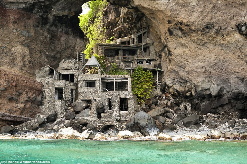 in the 1960s they ended up buying the entire 30-acre plot beneath the natural arch of volcanic rock with the dream of building their ideal hideaway home, which is now in need of restoration