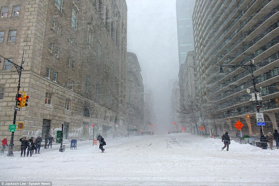 A New York woman cross-country skis across Columbus Circle after Storm Jonas battered the East Coast of America