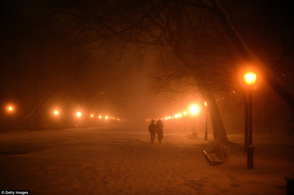 A couple take a stroll in Riverside Park in New York which is covered in the white stuff after a day of heavy snowfall in the East Coast