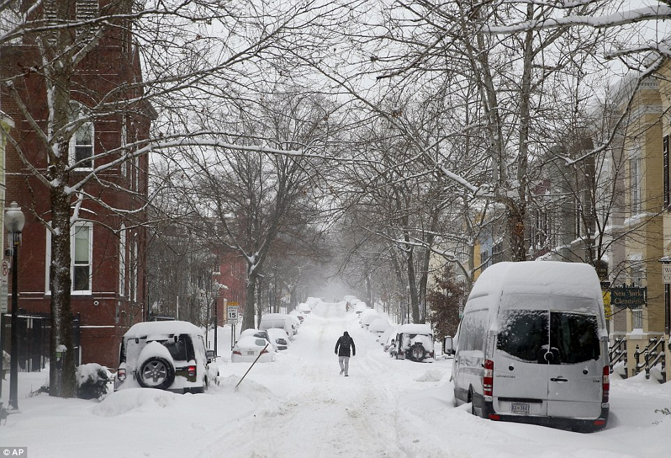 A man makes his way through the snow on Saturday, in the Georgetown area of Washington, as Storm Jonas battered the East Coast