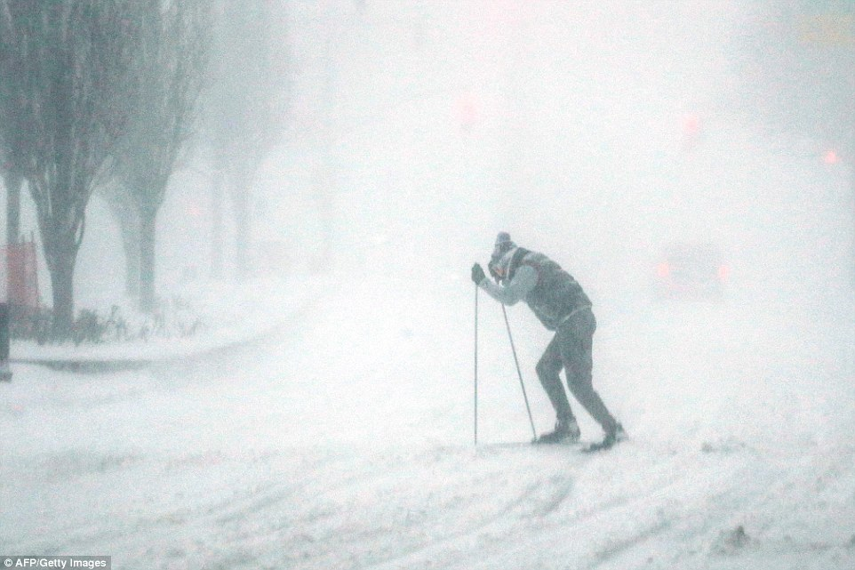 A man uses skis to make his way around Manhattan in near white-out conditions on Saturday as winter storm Jonas blankets the city in snow