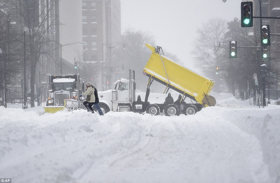 Dumper trucks were brought to the streets in Washington to help deal with the feet of snow that has fallen since Friday