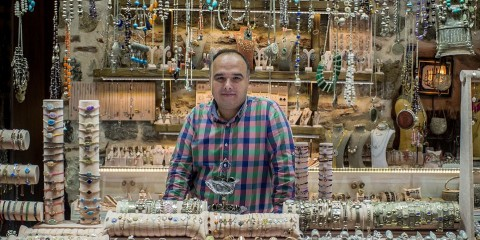 Mehmet Onlu sells silver jewellery inside the Istanbul Grand Bazaar and provides a service with a smile