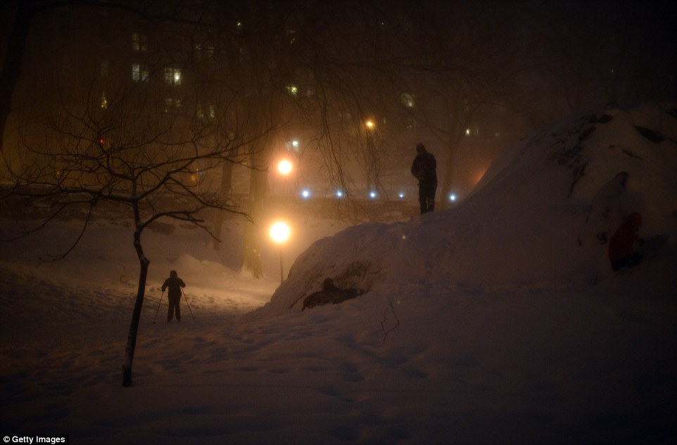 People enjoy the heavy snowfall at Riverside Park in New York City as Storm Jonas battered the East Coast of America yesterday