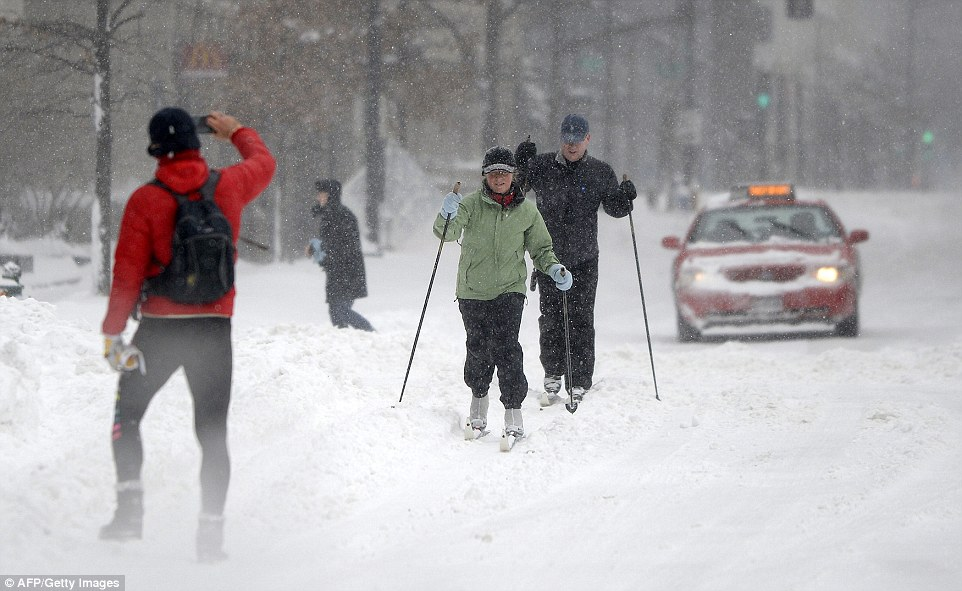 Several pedestrians gave up walking and took to using skis instead during very heavy snowfall in Washington on Saturday afternoon