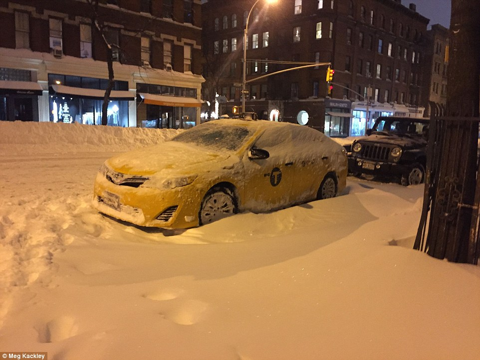 The National Weather Service warned the worst is still to come for many parts today. Pictured is a now-covered street in New York