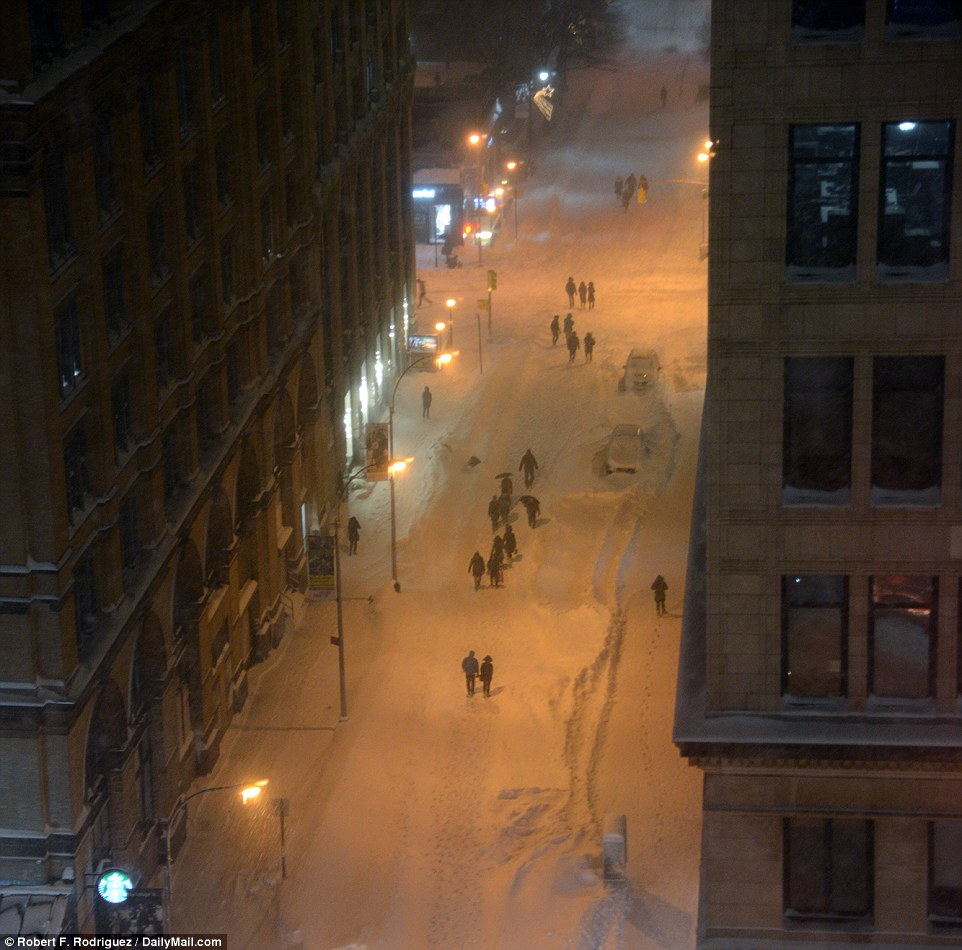 The travel ban left man walking through the un-shoveled sidewalks and the rarely empty streets of New York City on Saturday evening