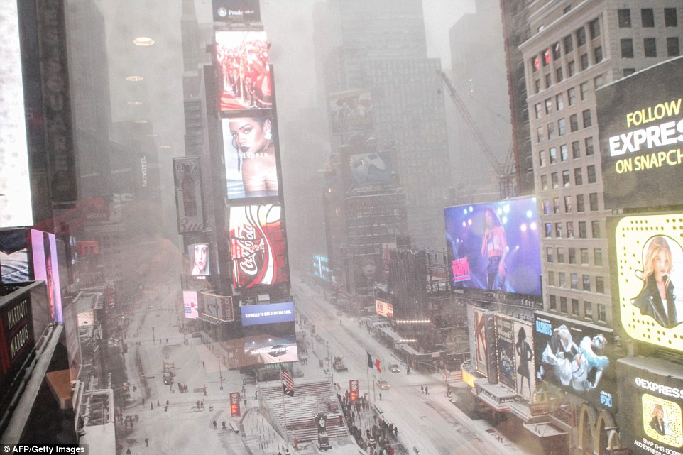 Times Square is seen while snow falls in New York City on Saturday. The city saw more than 25 inches as storm Jonas hit