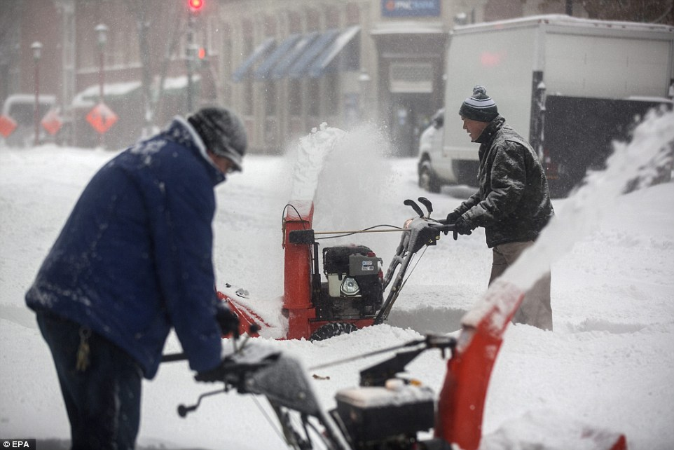 Workers in Washington D.C. have been working frantically on Saturday to try and keep roads and sidewalks open as snow continues to fall for the second day, and will not stop until Sunday