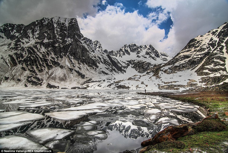 Rightly known as 'heaven on earth', this is half frozen alpine lake in the meadows of Kashmir looks almost surreal as the peaks throw their reflections into the water