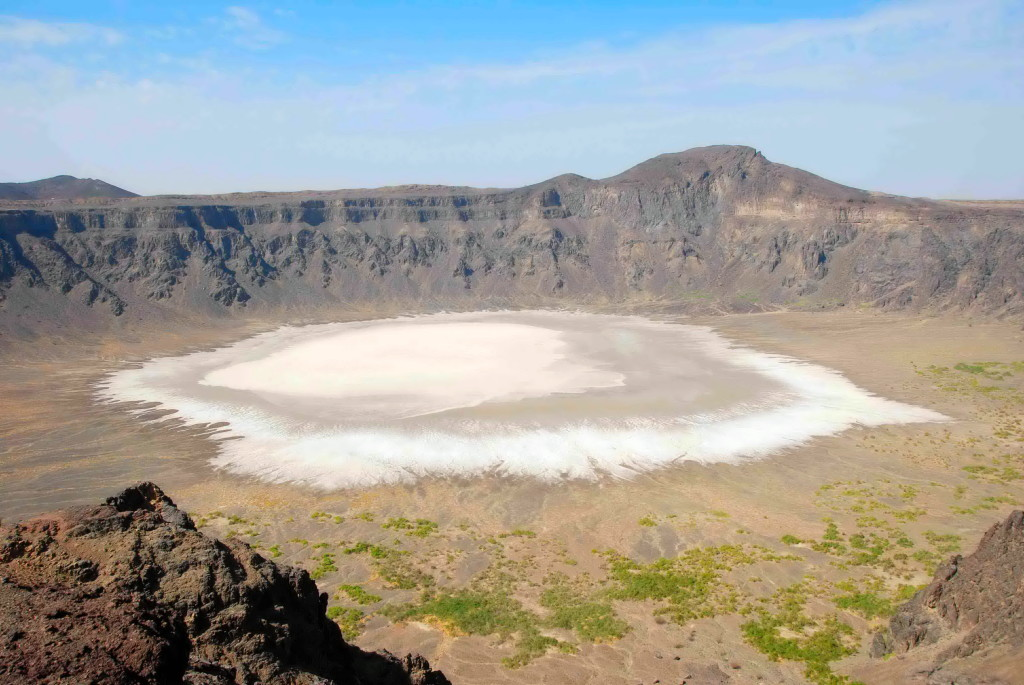 Al Wahbah Crater is an impressive pock mart on the earth holding stunning salt flat in its depth.