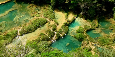 Semuc Champey is a natural wonder tucked away in the mountains of an isolated jungle in Guatemala