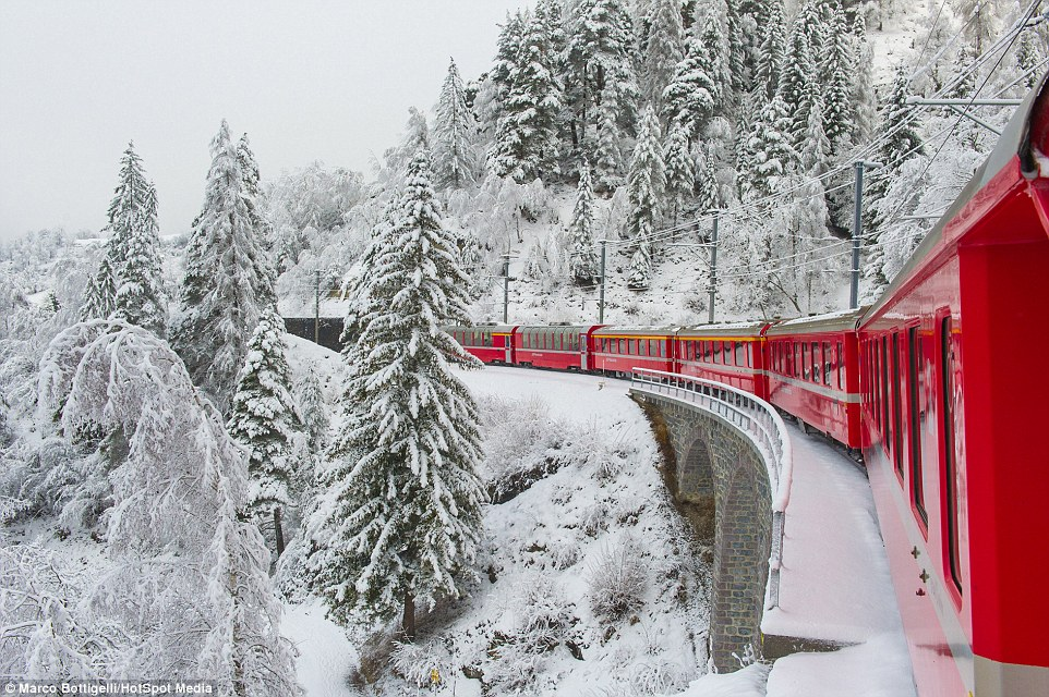 The Bernina Express, which connects Chur in eastern Switzerland to Tirano in northern Italy, runs along the highest railway line in the Alps. Pictured is train in the Albula valley, Graubünden