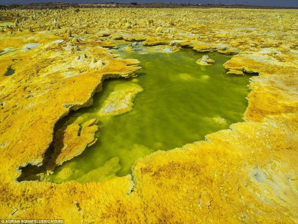 The Dallol Volcano, in Ethiopia, is an endless yellow-orange landscape, its craters stretching for miles around