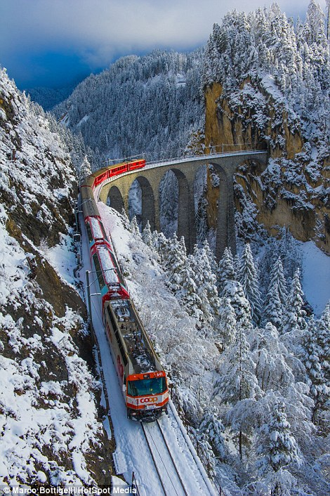 The train looks striking against the snowy backdrop behind the Schmittentobel Viaduct in Schmitten (left) and the Landwasser Viaduct in Filisur