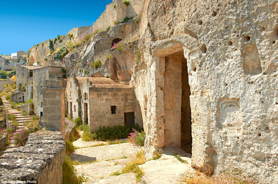 "In the Basilicata region, in Southern Italy, there's an ancient city called ""Matera"" well-known for its cave houses called ""Sassi""."