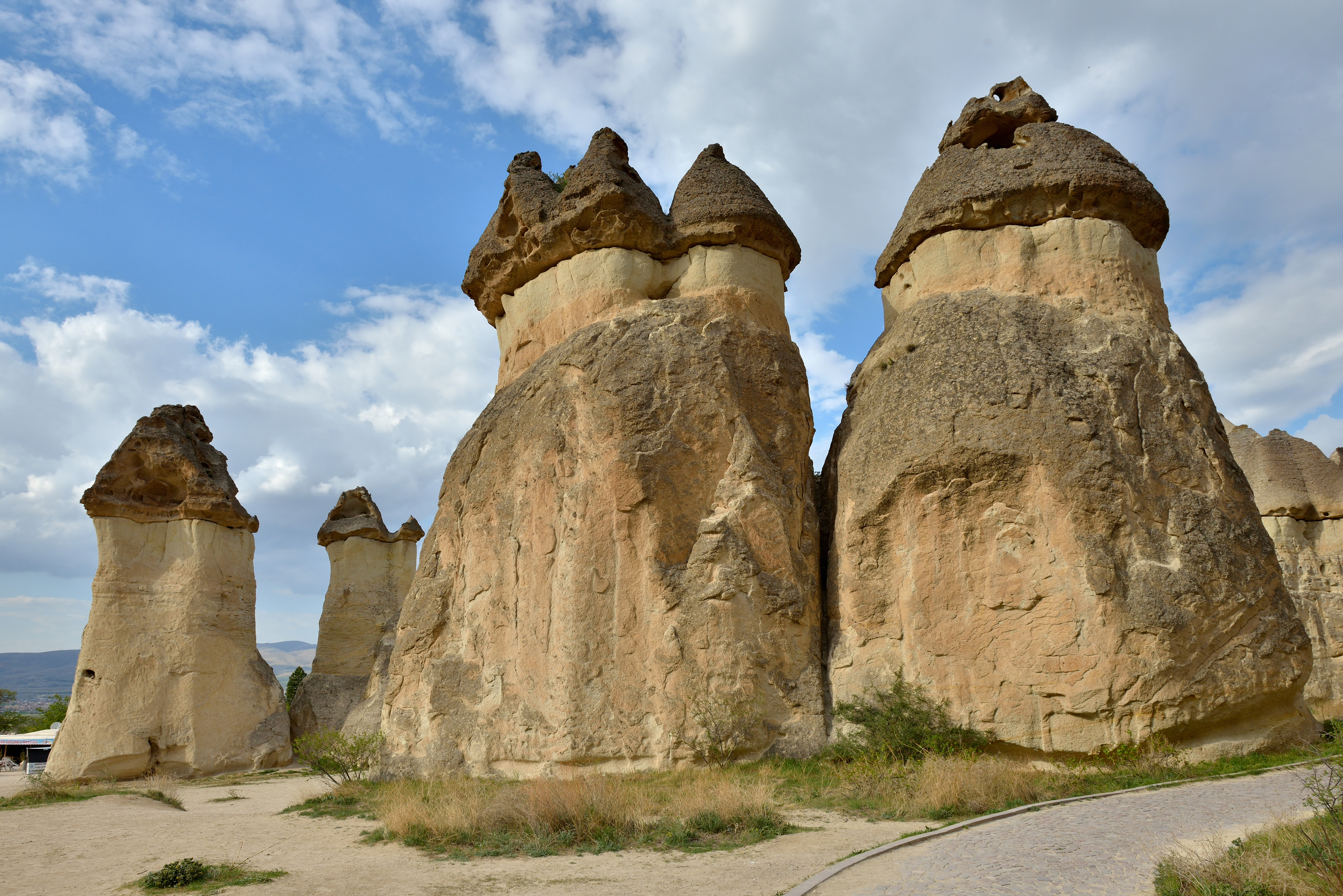 the lengthy work of erosion instigated, the softer tuff wore down, giving way to pillars, stand as tall as 130 feet