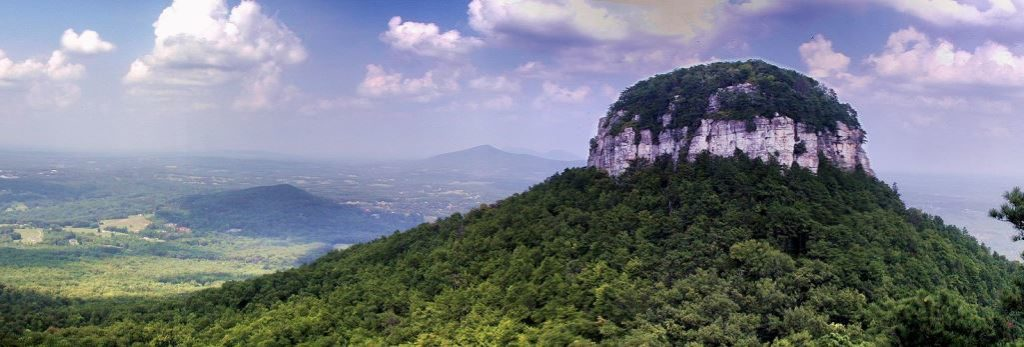 Pilot Mountain is part of Pilot Mountain State Park, stretching to the Yadkin River via a corridor of Land, and associated with adjacent Horne Creek Living Historical Farm.