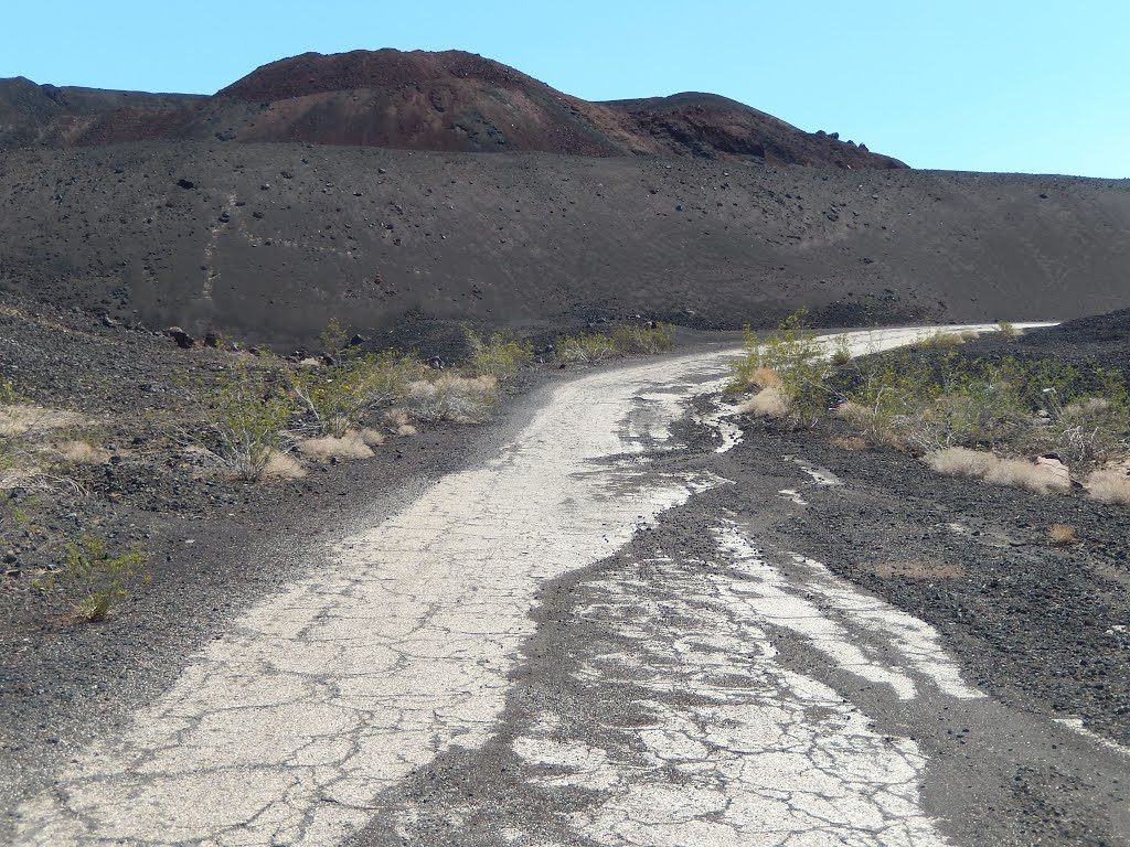 Due to natural erosion and mining operation the crater has lost of must it's original cinder cone shape.