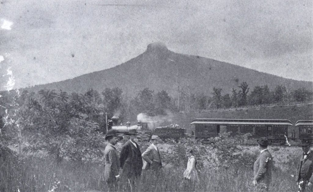 An excursion train within sight of Pilot Mountain in 1891