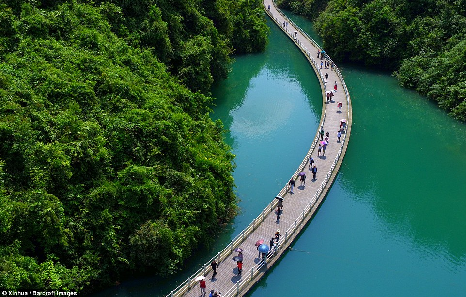 The floating walkway in central China allows visitors to see a part of a valley that's only accessible by rowing boat
