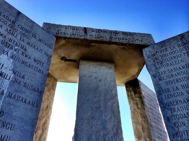 The height of monument is 19 feet 3 inches made with granite slabs. One slab stands in the center with 4 arranged around it, with a capstone lies on top of five slabs.