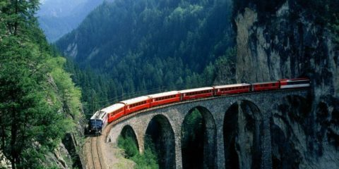 Switzerland's Glacier Express travels across 291 bridges, through 91 tunnels and crosses the Rhone and the Rhine