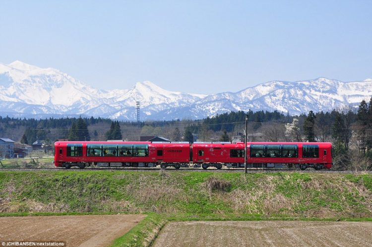 The tourist train trundles across a magnificent landscape, with passengers able to see every contour