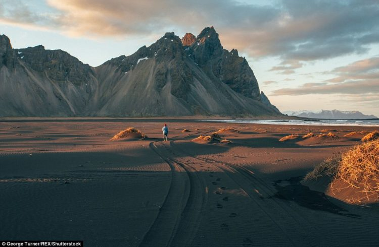 A picture of the Icelandic Mount Vestrahorn, overlooking the Atlantic Ocean. The spot is very popular among photographers