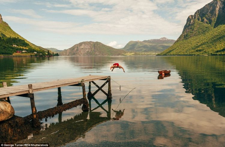 Diving into an empty lake during a month-long trip to Norway to capture the rural scenery
