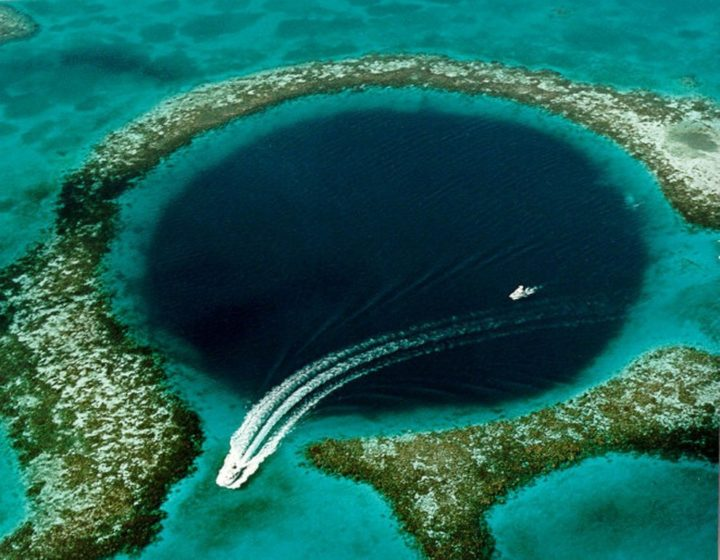 The Great Blue Hole a large submarine sinkhole off the coast of Belize, over 300m across and 124m deep.
